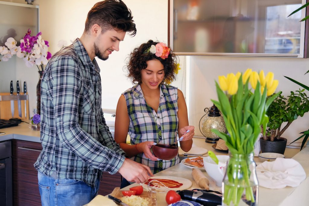 Couple making Pizza | Featured image for 3 simple reasons why buying is better than renting blog