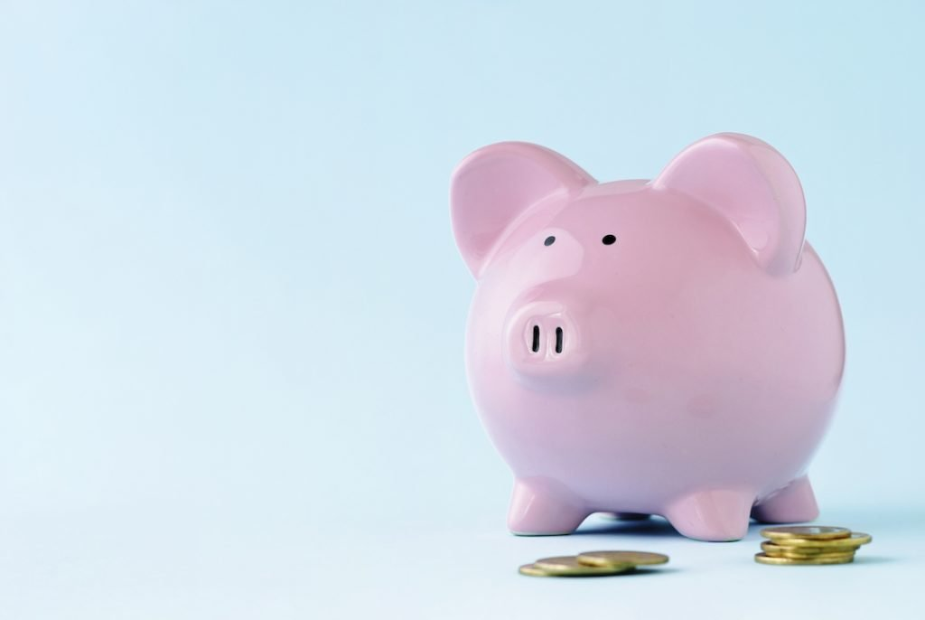 pink piggy bank | Featured image for 4 Ways to Help Fill Your Piggy Bank Faster blog