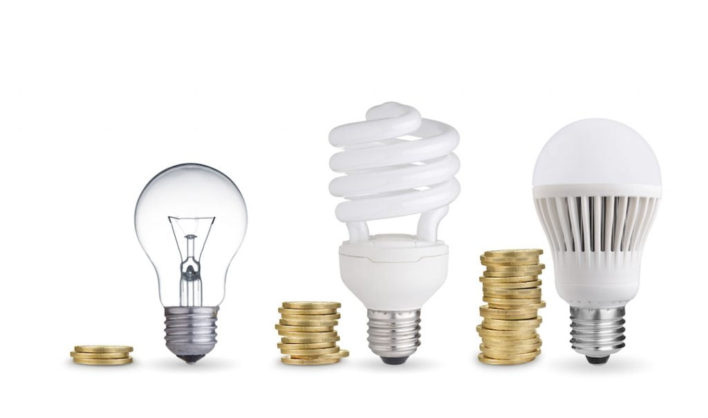 lightbulbs and coins in a row | Featured Image For 4 Great Ways to Save for an Investment Property in the New Year blog