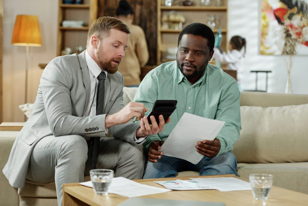 two men sitting on couch | Is it Time to Review Your Interest Rate? blog