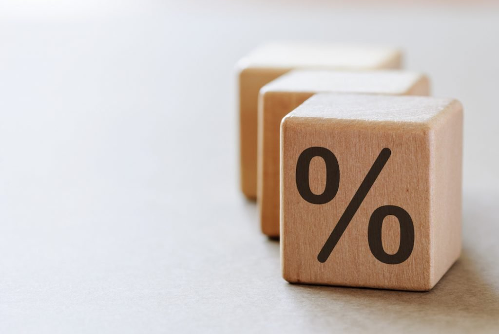 Wooden dice with percentage symbol |Featured Image For Cash Rate Remains at Historic Low - April 2018 blog