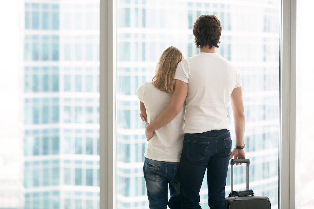Couple standing infront fo window | Feature Image For What is the Ideal Property Type for Your First Home? blog