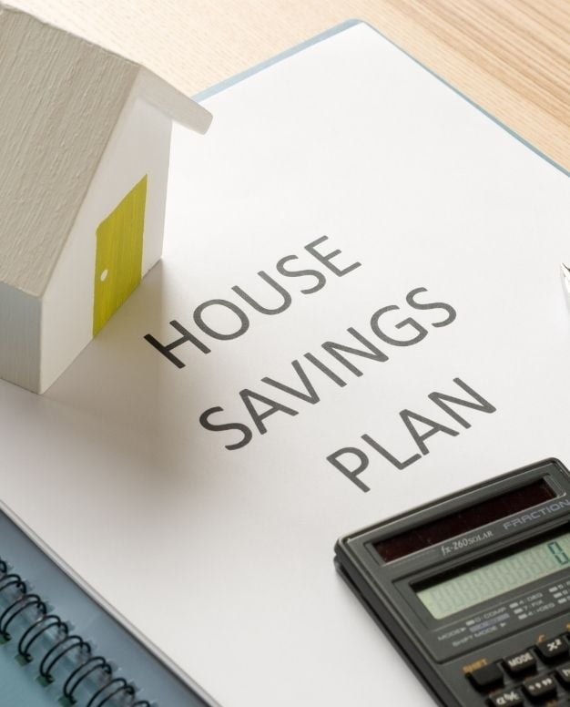 house and calculator | featured image for saving for a house deposit blog