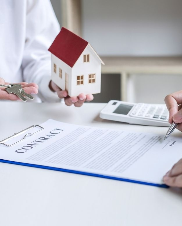 A man signing a property contract | How to Get Approved for a Home Loan Blog Featured Image