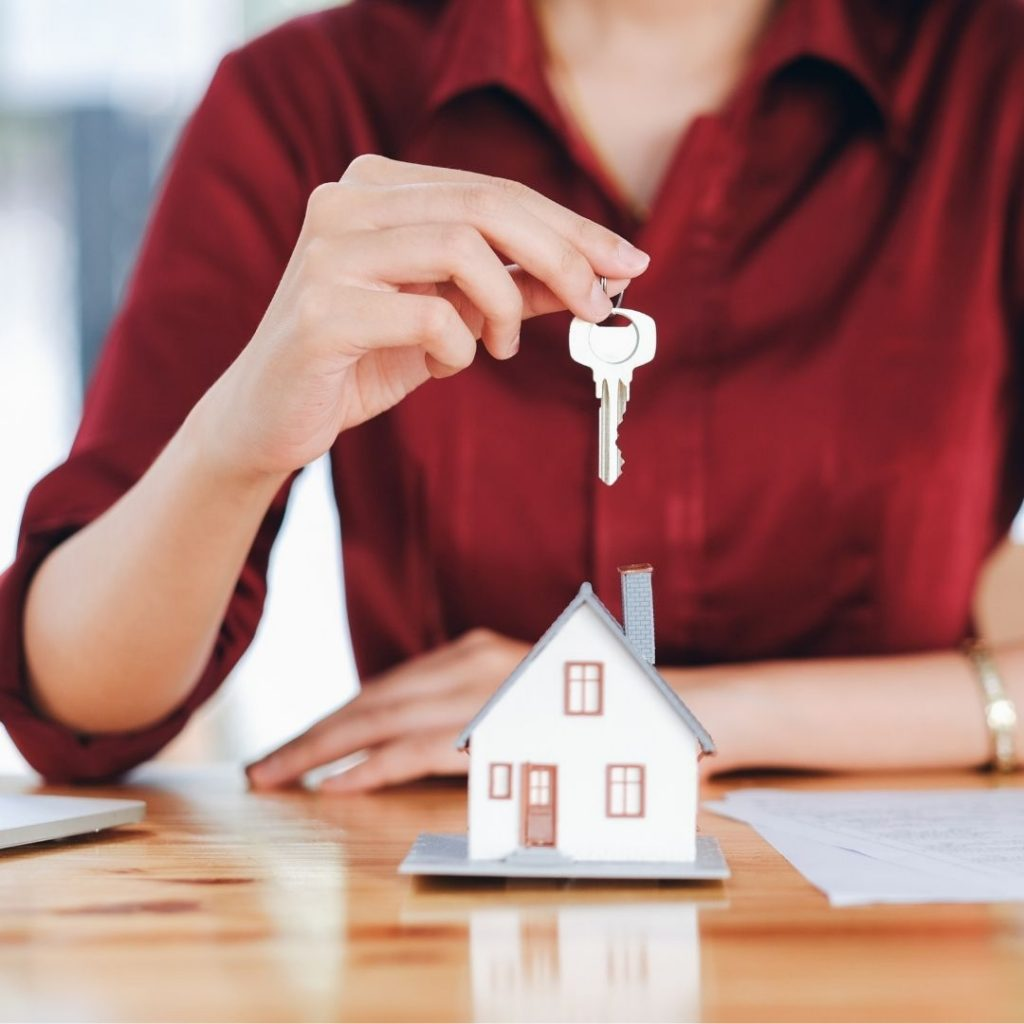 Lady holding house keys | Featured image for Buying Property Through Super | Blog